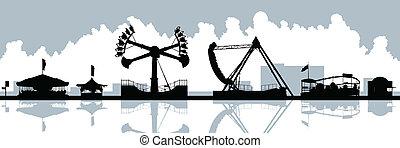Skyline silhouette of amusement park rides.