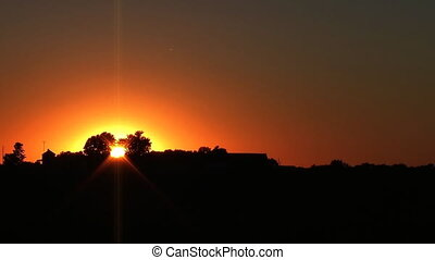 Midwest Farmhouse Sunset - Time-lapse of sunset behind...