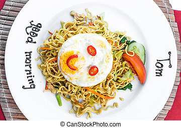 Mie goreng ayam, fried noodle with chicken. Indonesian traditional dish.