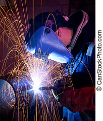 MIG welding on steel tube - Welder uses torch to make sparks...