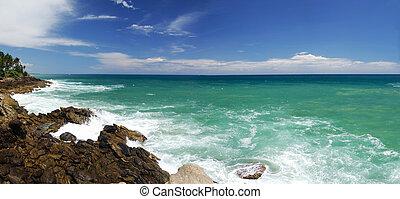 Mighty waves are striking the rocky coast of Souhern Sri Lanka. Panorama