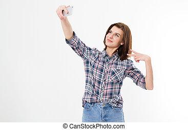 mignon, brunette, sur, deux, gai, jean, girl, désinvolte, isolé, long, arrière-plan., séduisant, blanc, agréable, adorable, selfie, gentil, femme, projection, doigts, flirty, cheveux, chemise, élégant