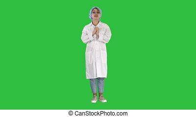 mignon, docteur femme, monde médical, chroma, écran, conversation, appareil photo, vert, key., sourire