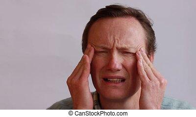 migrain attack - a man suffering from attack migrain and...