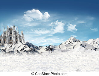 Milan Cathedral among the mountains with snow and blue sky...