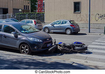 MILAN, ITALY - APRIL, 16: Scooter crash in the urban street on April 16, 2014