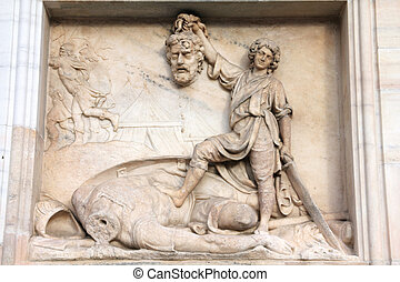 Milan, Italy. Famous landmark - the cathedral made of Candoglia marble. David and Goliath - biblical story.