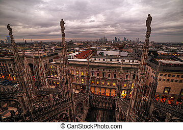 Milan, Italy: gothic roof of Cathedral in sunset