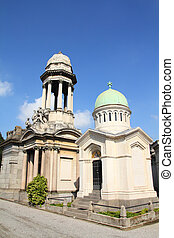 Milan, Italy. Famous landmark - old graves at the Monumental Cemetery (Cimitero Monumentale). Religious art.