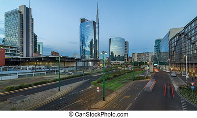 Milan skyline with modern skyscrapers in Porta Nuova business district day to night timelapse in Milan, Italy, after sunset.