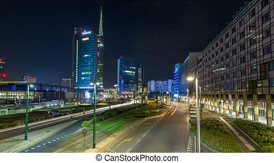 Milan skyline with modern skyscrapers in Porta Nuova business district night timelapse hyperlapse in Milan, Italy