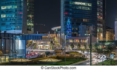 Milan skyline with modern skyscrapers in Porta Nuova business district night timelapse in Milan, Italy, after sunset.