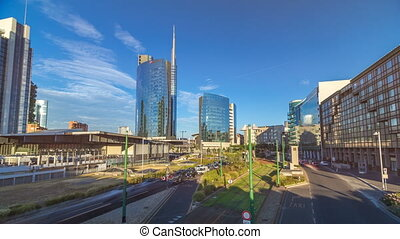 Milan skyline with modern skyscrapers in Porta Nuova business district timelapse hyperlapse in Milan, Italy, at sunset.