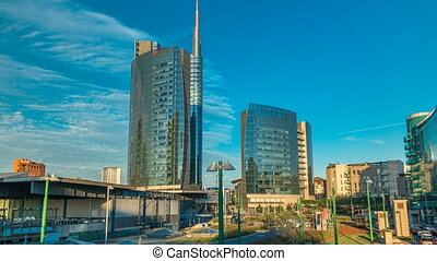 Milan skyline with modern skyscrapers in Porta Nuova business district timelapse in Milan, Italy, at sunset.