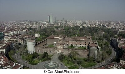 Everyday life in Milan, Italy during COVID-19 epidemic. Milano, Italian city and coronavirus quarantine. Aerial view of historic building: Castello Sforzesco seen from drone flying in sky
