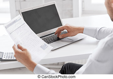miling businessman working in office - business and office...