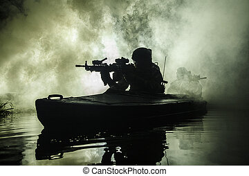 Militants in army kayak - Backlit silhouette of special...