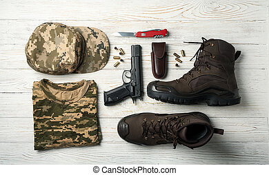 Military accessories on white wooden background, top view