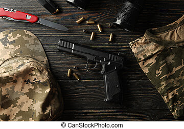 Military accessories on wooden background, top view