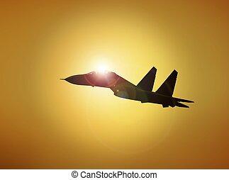 Military Aircraft Flying at Sunset