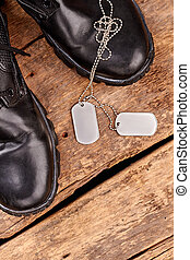 Military army boots and dog tags.