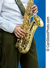 military brass band musician with tsaxophone in his hands