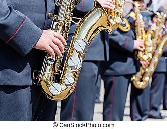 military brass band musicians with gold saxophones
