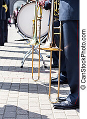 military brass band musicians with trombones