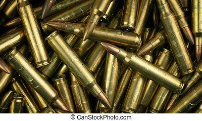 Military Bullets Rotating Macro Shot - Closeup of machine...