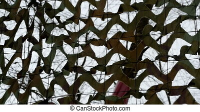 military camouflage net background - View from under the...