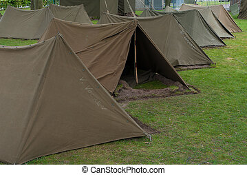 military camp - small military tents in a row