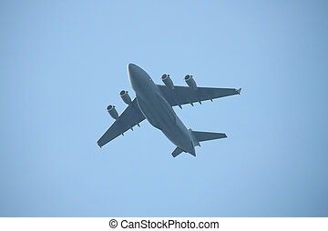 Military cargo plane flying over
