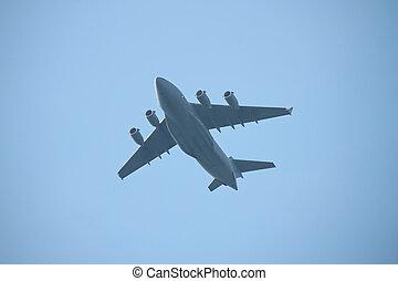 Military cargo plane flying over
