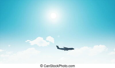 Military cargo plane silhouette in blue sunny sky 4K