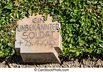 military cemetery in Germany with grave of an unknown soldier from the 2nd world war