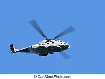 military combat helicopter while flying over territory