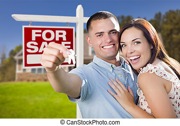 Military Couple In Front of Home, House Keys and Sign