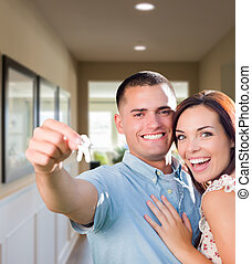 Military Couple with House Keys Inside Hallway