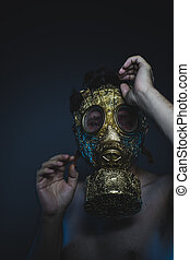 military, depression and danger man with golden gas mask