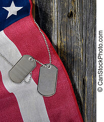 military dog tags on American flag