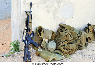 Military Equipment - An Israeli army weapon and uniform in a...