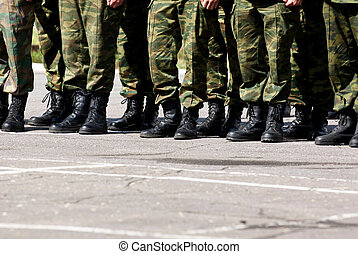 Military feet - Closeup view of soldiers lined up in a row