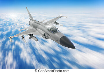 Military fighter aircraft at high speed, flying high in blue sky.