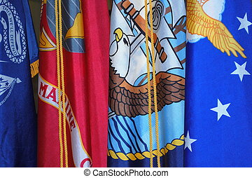 Military flags. - Military flags displayed indoors.