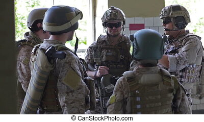 Military gathering - Soldiers gathering to discuss their...