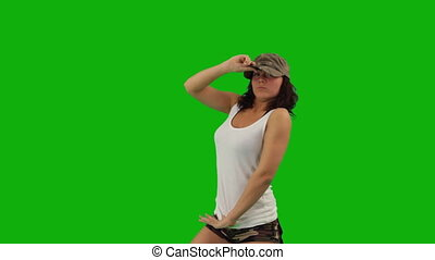 Military girl dancing hip-hop against green screen