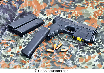 military handgun with a tactical laser/light-module - 9mm...