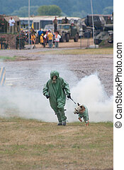 ZHUKOVSKY, RUSSIA - JULY 3: military handler and his dog in anti-CW outfit demonstrate skills on the Forum ET-2010 on July 03, 2010 in Zhukovsky, Russia