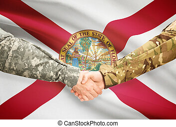 Soldiers handshake and US state flag - Florida