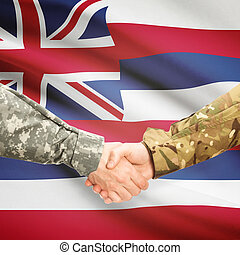 Military handshake and US state flag - Hawaii